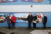 Steveston Historical Society Executive Director, Sarah Glen; Gulf of Georgia Cannery Society Executive Director, Rebecca Clarke; SHA Operations Supervisor, Joel Baziuk; and mural artist, Victoria Oginski at the reveal of the public mural project in December, 2015