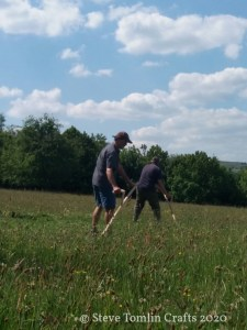 scything a wildflower meadow in Yorkshire Dales