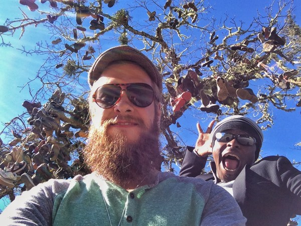 Selfie photobombed on highway 36 with a tree full of shoes.