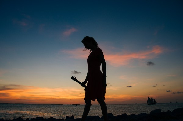 Photo of silhouette of a girl during sunset in key west, florida.