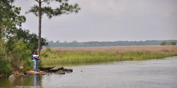 photo by stevie vagabond of man fishing in portage creek, pensacola