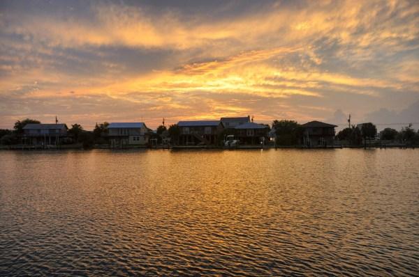 photo of the sun setting over daughin island alabama