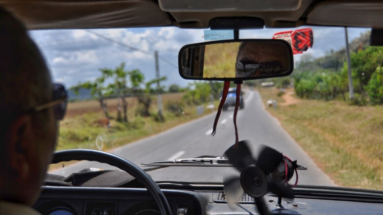 Photo inside a cuban taxi in Nueva Gerona, Cuba by Stevie Vagabond