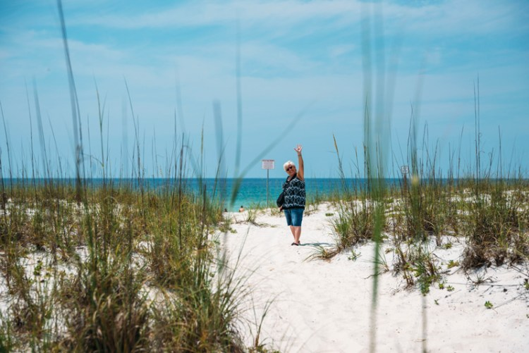 Mom waving on pensacola beach