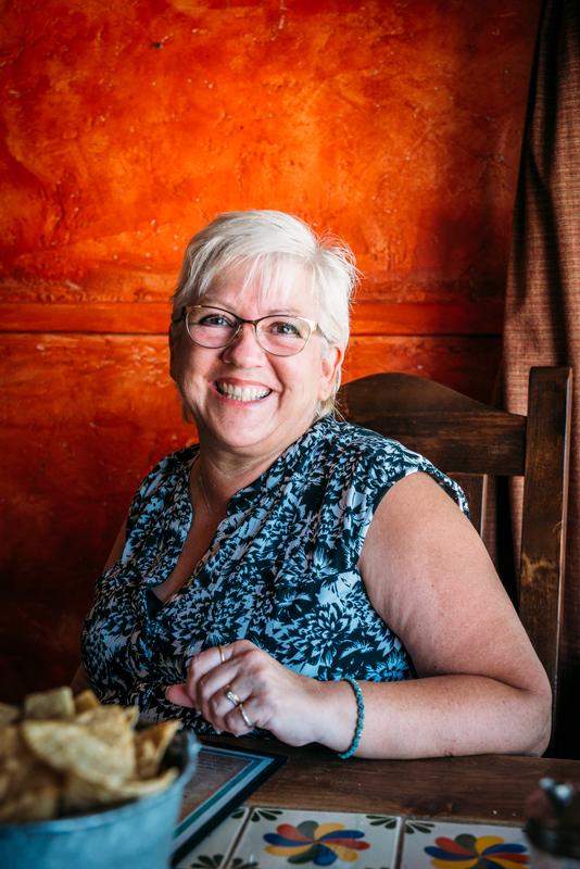 Portrait of Stevie Vagabond's mother inside La Nueva Casita Cafe in Las Cruces, New Mexico.
