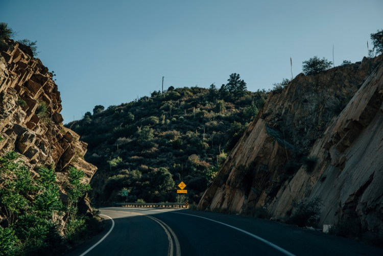 Photo of a road running between two hills in Arizona.