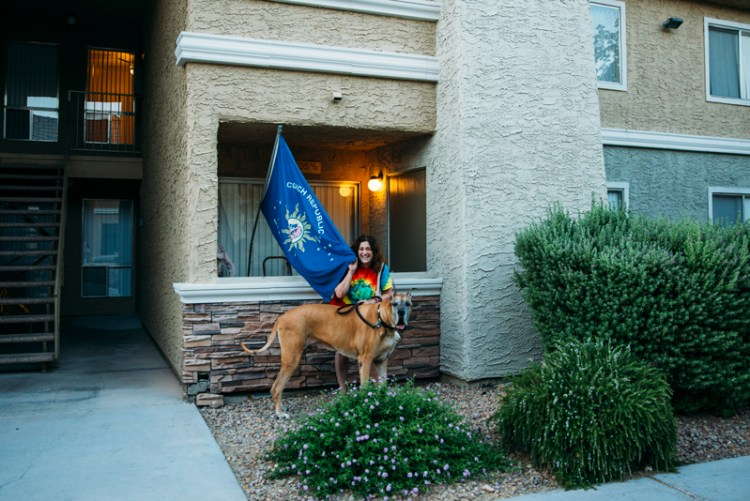 Lesley and Valentino with the Conch Republic flag outside their home in Las Vegas
