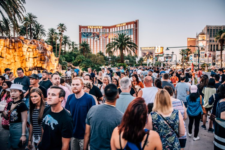 Vegas Strip Filled with People and Treasure Island in the background.