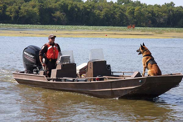 Canines like Rudi, whose handler is federal wildlife officer Darryn Witt at Upper Mississippi National Wildlife and Fish Refuge, are skilled at protecting officers and sniffing out contraband. (Eric Tomasovic/USFWS)