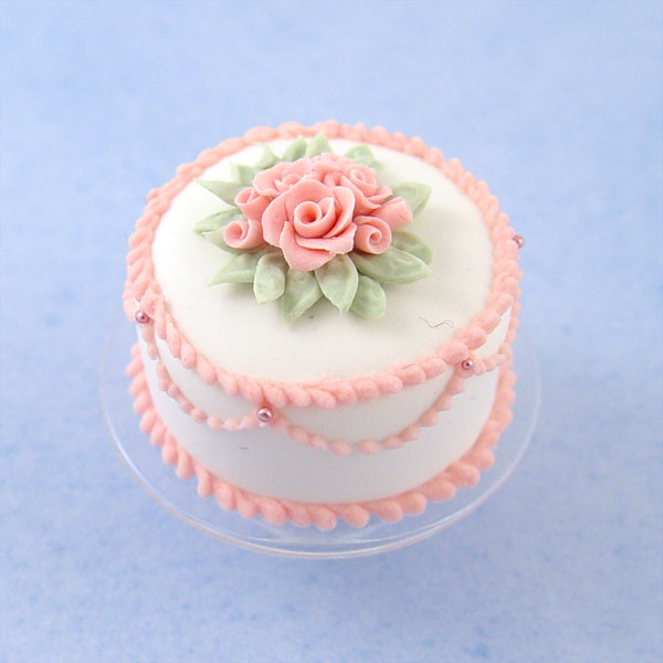 Miniature White Cake W Pink Roses On A Glass Cake Stand