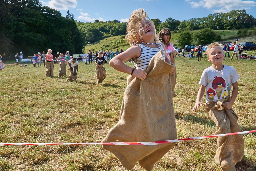 child winning the sack race at the big picnic