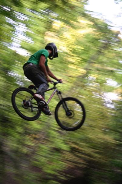 mountain biker in mid air on bike