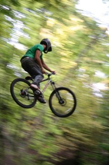 mountain biker in mid air on bike