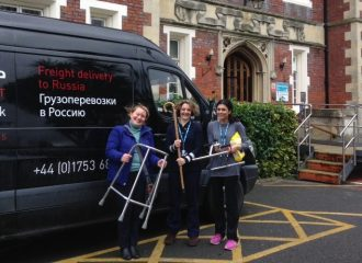Supporters with donated zimmer frames