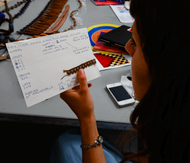 Aimee Betts looking at Jessica Light's notes, Slow Textiles Group event, 2014