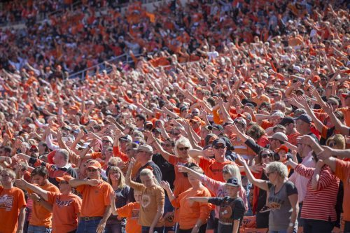 Waving Song fans Oklahoma State Cowboys