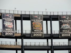 New England Patriots banners of four super bowl championships at Gillette Stadium