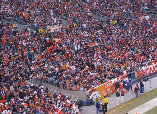 fans watching a Denver Broncos game in Empower Field at Mile High