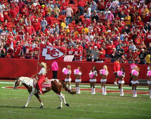 Kansas City Chiefs fans cheerleaders Warpaint horse and rider