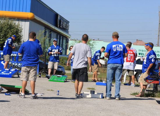 Indianapolis Colts fans play Cornhole at a tailgate lot