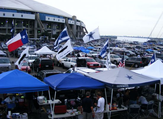 Dallas Cowboys fans tailgate outside stadium