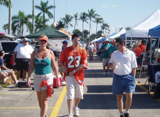 fans party in tailgate lot at a Miami Dolphins game