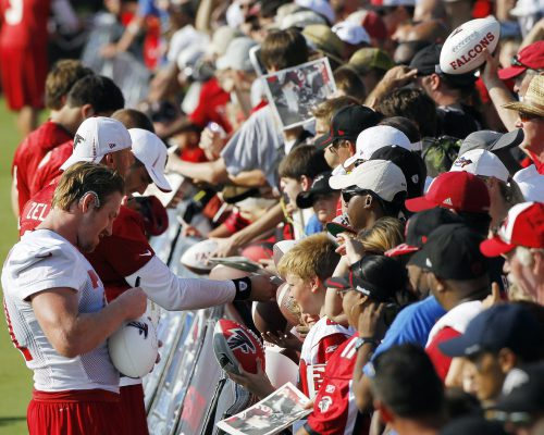 Atlanta Falcons players sign autographs for fans
