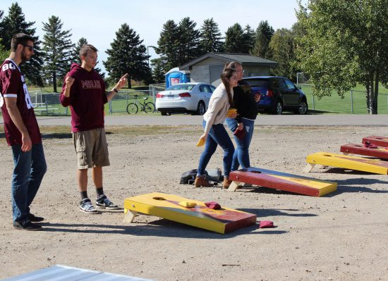 Minnesota Gophers fans playing cornhole game