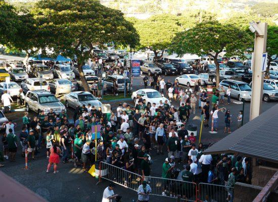 Hawaii Rainbow Warriors football fans tailgating outside Aloha Stadium