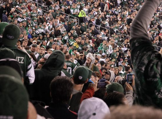 New York Jets fans cheering at the game