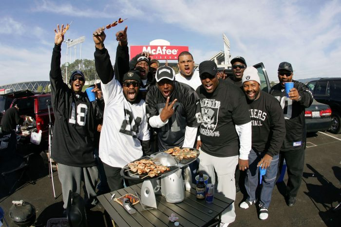 Oakland Raiders tailgaters party at the parking lot