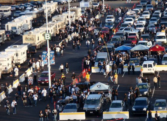 Oakland Raiders fans tailgating at parking lot