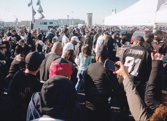 fans party in tailgate lot at Oakland Raiders game