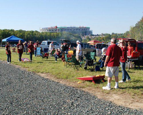 Washington Redskins tailgaters play cornhole game on tailgate lot outside FedEx Field