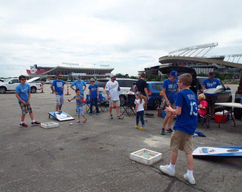 Kansas City Royals kids playing cornhole at parking lot