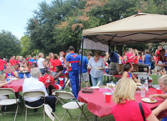 SMU Mustangs fans at tailgate area on football gameday