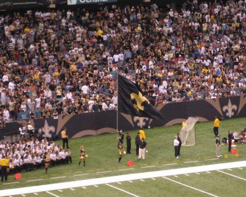 New Orleans Saints flag fans cheerleaders