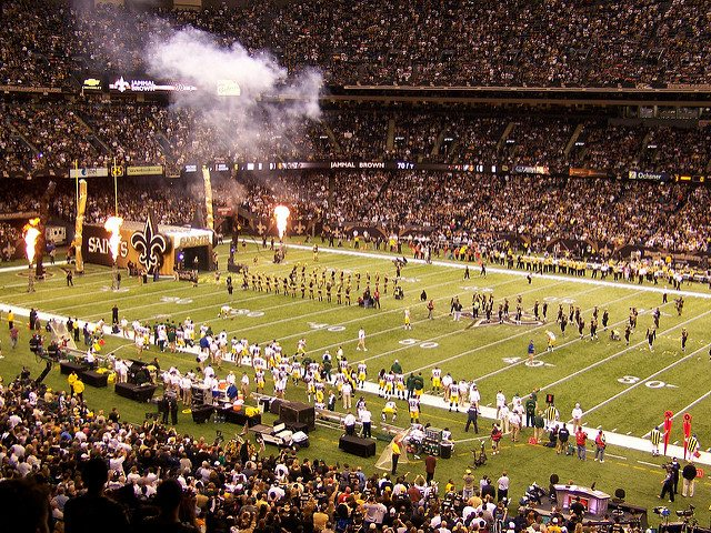 New Orleans Saints fans players cheerleaders and fire display at Mercedes Benz Superdome