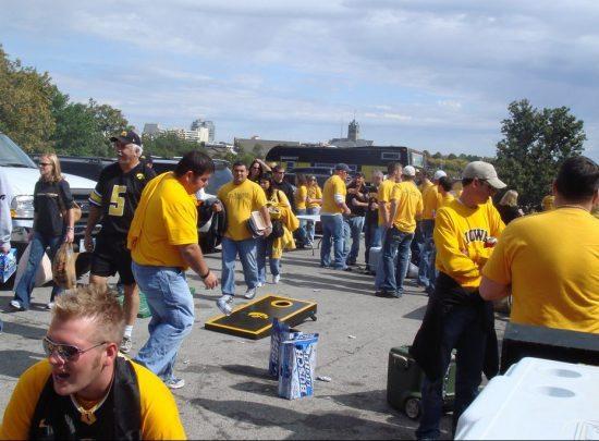 cornhole game at Iowa Hawkeyes tailgate