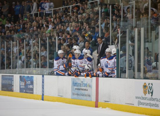 Edmonton Oilers team at the bench