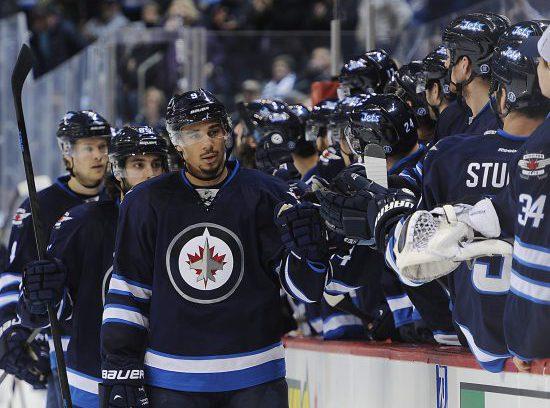 Winnipeg Jets hockey teammates at the bench