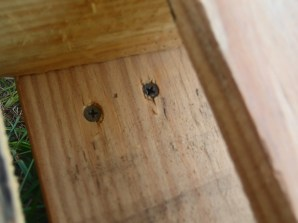 Screwed into the bottom slat to attach from the top