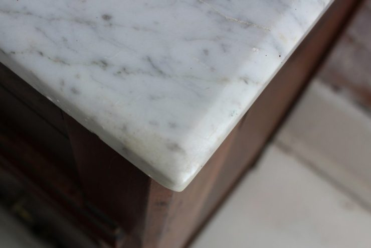 sticks and brick marble top dresser