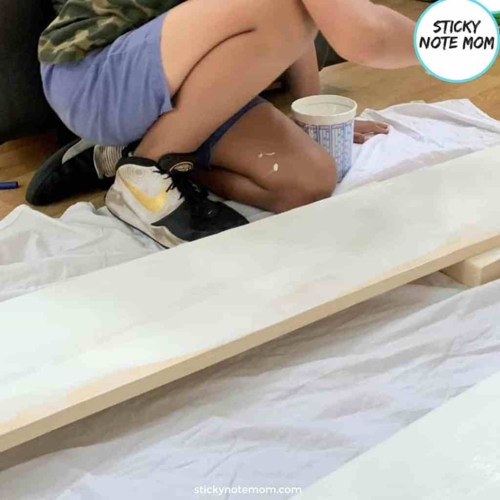 Kid painting boards white
