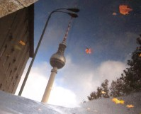 Berlin TV Tower reflected in puddle
