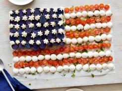 Caprese Salad American flag with purple potatoes, tomatoes and mozzarella photo via foodnetwork.com