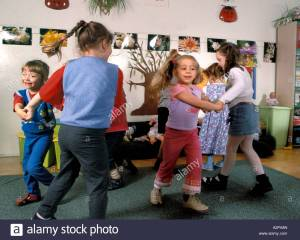 nursery-school-children-dancing-kindergarten-A2PA8N