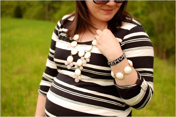 maternity style: black and white striped maternity dress, black boots, white bubble necklace and bubble bracelet