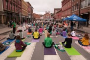 ...out come the yoga mats for Yoga on State Street!