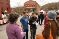 Two cast members of Hairspray, a fabulous local production, talking with shoppers at the market